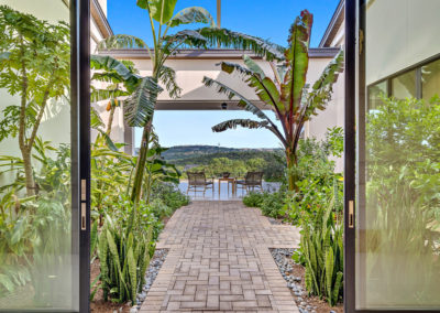 Tropical courtyard brings Costa Rica to Austin with retractible roof and wall